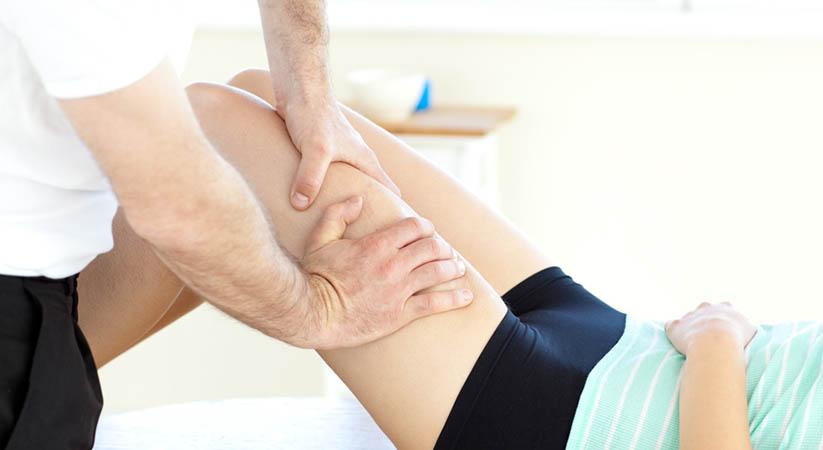 Close-up of a woman receiving a leg massage in a health club
