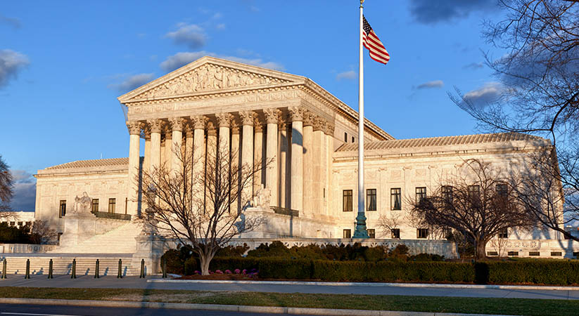 Late afternoon winter sun illuminates front of supreme court in Washington in winter